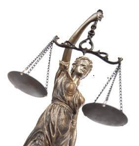 Bronze statuette holding up scale of justice